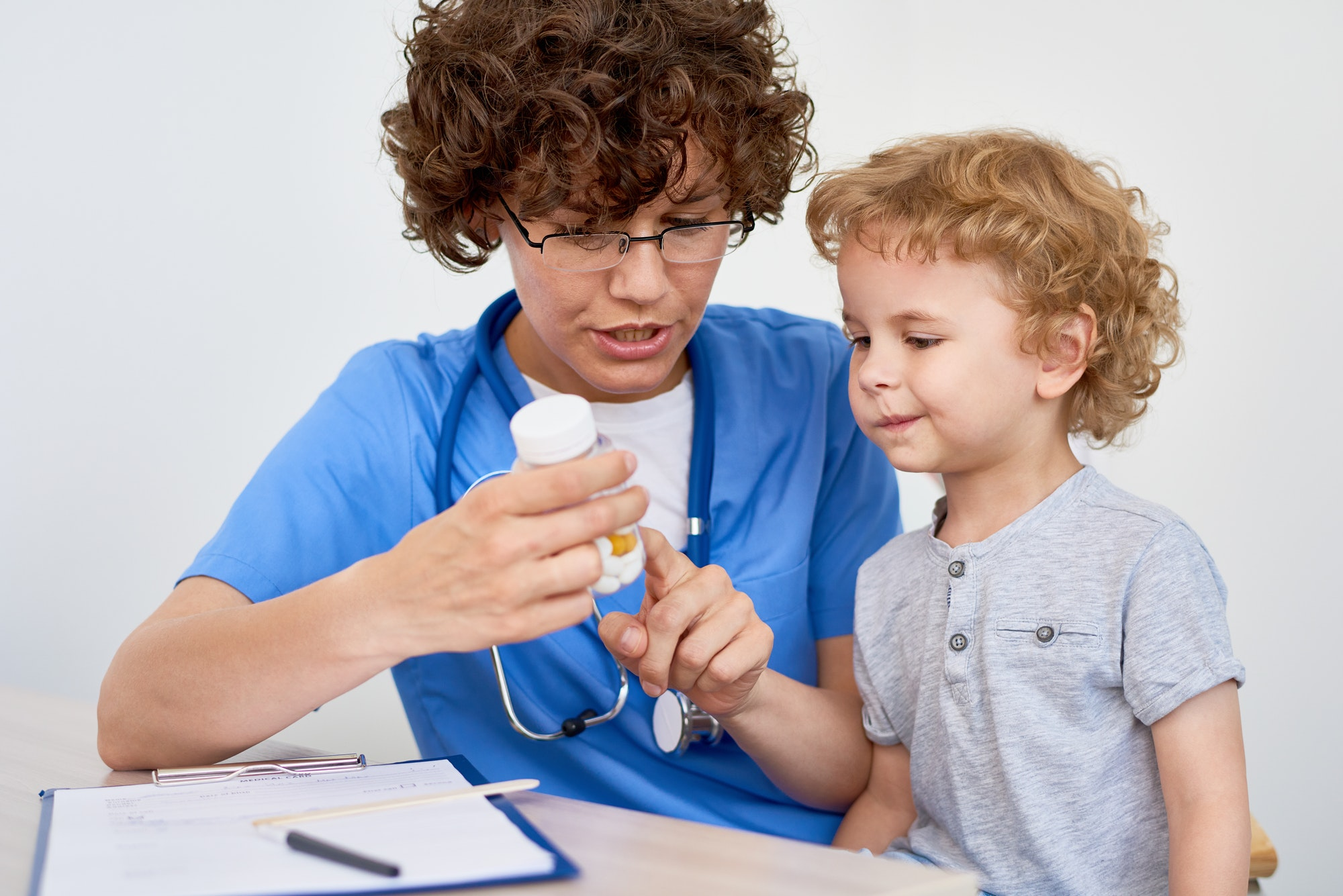 Nurse Giving Vitamins to Little Child