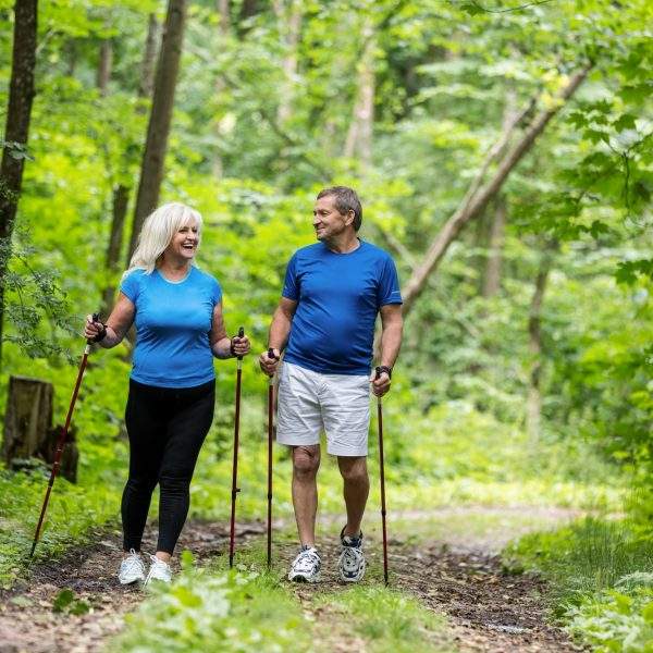Elderly couple enjoying summer walk.